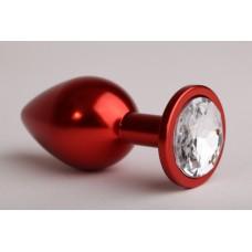 Металлическая пробка красного цвета с прозрачным кристаллом